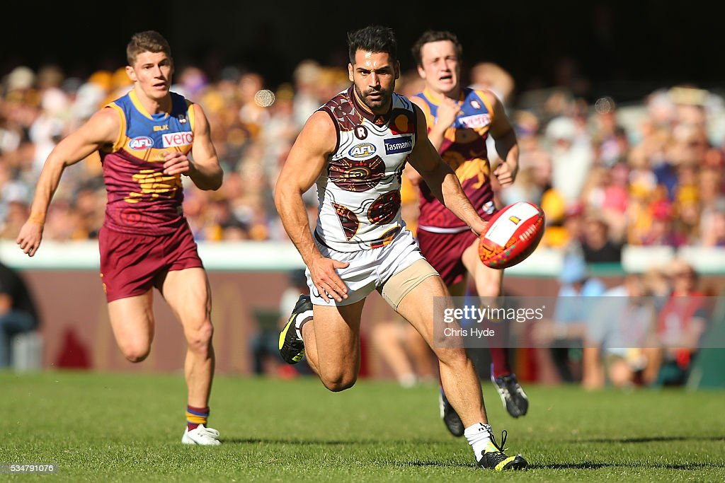 Paul Puopolo of the Hawks runs for the ball during the round 10 AFL match between the Brisbane Lions and the Hawthorn Hawks at The Gabba on May 28, 2016 in Brisbane, Australia.