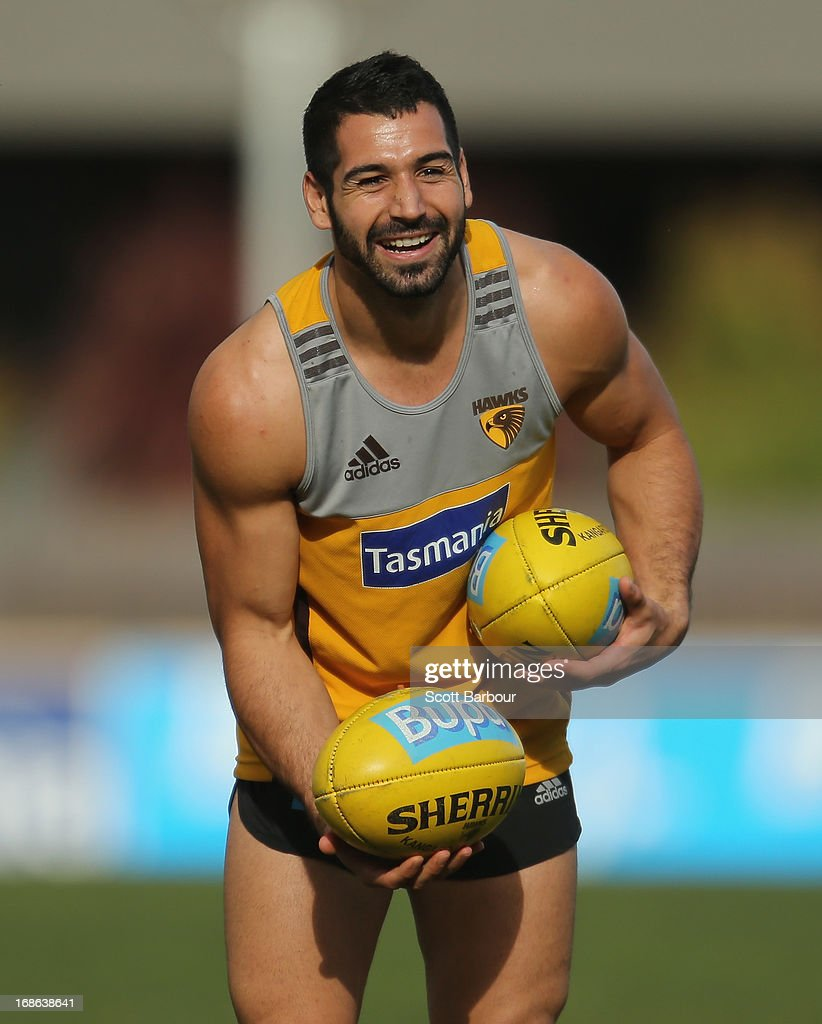 Paul Puopolo of the Hawks smiles during a Hawthorn Hawks AFL training session at Waverley Park on May 13, 2013 in Melbourne, Australia.