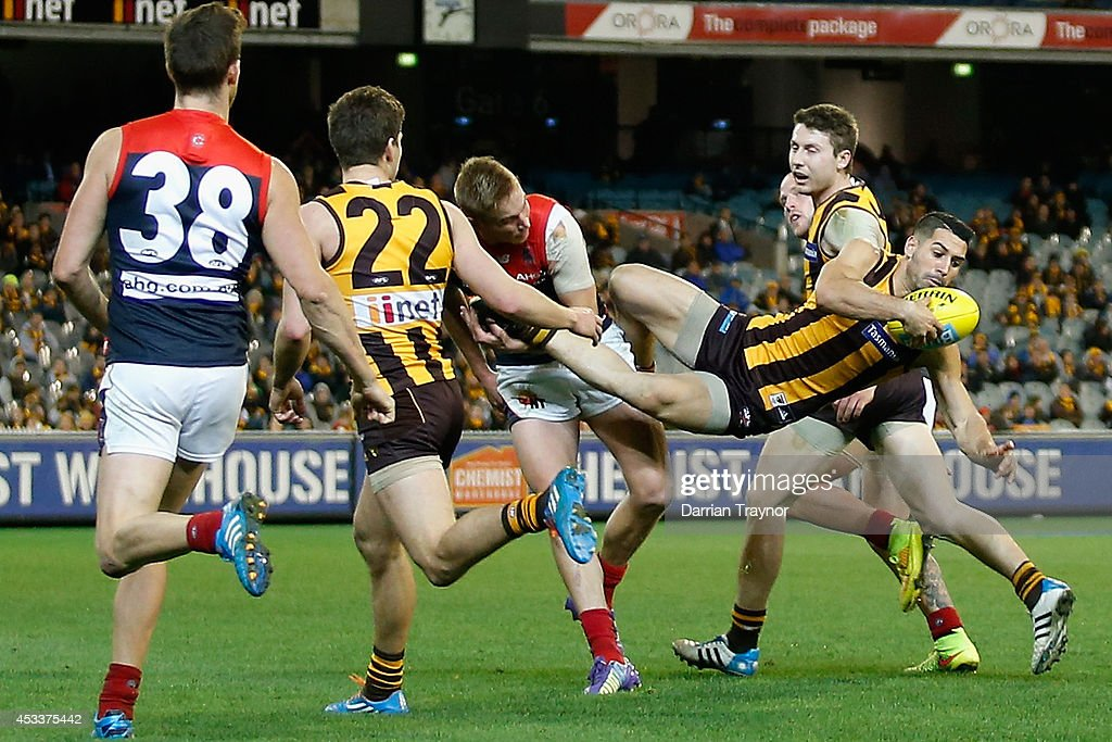 Paul Puopolo of the Hawks takes a spectacular mark during the round 20 AFL match between the Hawthorn Hawks and the Melbourne Demons at Melbourne Cricket Ground on August 9, 2014 in Melbourne, Australia.