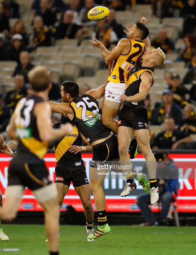 Paul Puopolo of the Hawks takes a spectacular mark over Troy Chaplin of the Tigers during the 2016 AFL Round 07 match between the Richmond Tigers and the Hawthorn Hawks at the Melbourne Cricket Ground, Melbourne on May 6, 2016.