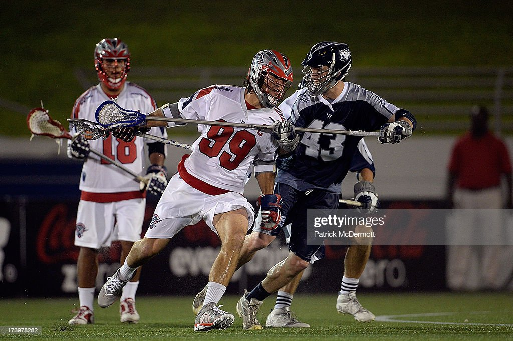 <a gi-track='captionPersonalityLinkClicked' href=/galleries/search?phrase=Paul+Rabil&family=editorial&specificpeople=4307127 ng-click='$event.stopPropagation()'>Paul Rabil</a> #99 of Boston Cannons battles against Barney Ehrmann #43 of Chesapeake Bayhawks during a game at Navy-Marine Corps Memorial Stadium on July 18, 2013 in Annapolis, Maryland.