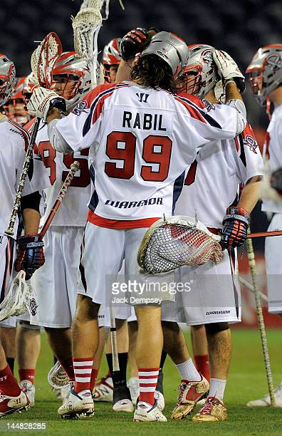 Paul Rabil of the Boston Cannons celebrates a win with goaltender Jordan Burke following an MLL lacrosse game against the Denver Outlaws at Sports...