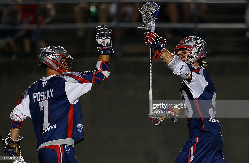 Paul Rabil #99 of the Boston Cannons celebrates his goal with Matt Poskay #7 in the second half against the New York Lizards at Harvard Stadium on June 21, 2013 in Boston, Massachusetts.