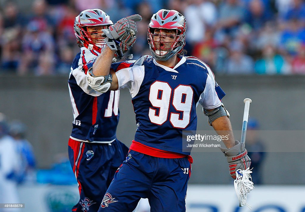 Paul Rabil of the Boston Cannons celebrates his goal with teammate Stephen Berger in the first half against the Charlotte Hounds during the game at...