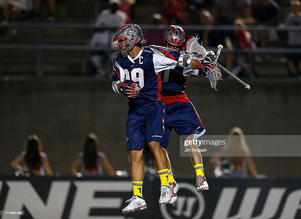 Paul Rabil #99 of the Boston Cannons celebrates his goal with Will Manny #0 in the second half against the New York Lizards at Harvard Stadium on June 21, 2013 in Boston, Massachusetts.