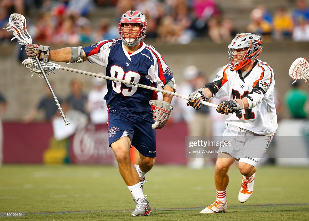 <a gi-track='captionPersonalityLinkClicked' href=/galleries/search?phrase=Paul+Rabil&family=editorial&specificpeople=4307127 ng-click='$event.stopPropagation()'>Paul Rabil</a> #99 of the Boston Cannons runs downfield with the ball in the first half past Dillon Roy #91 of the Denver Outlaws at Harvard Stadium on May 10, 2014 in Boston, Massachusetts.