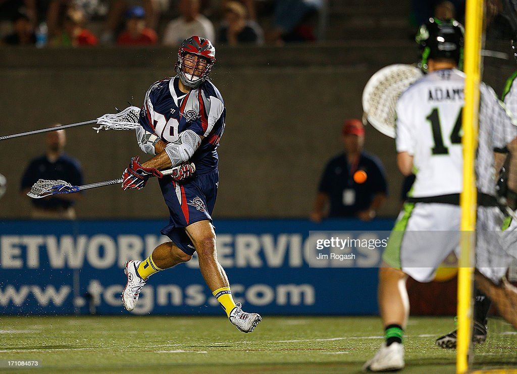 <a gi-track='captionPersonalityLinkClicked' href=/galleries/search?phrase=Paul+Rabil&family=editorial&specificpeople=4307127 ng-click='$event.stopPropagation()'>Paul Rabil</a> #99 of the Boston Cannons scores on Drew Adams #14 of the New York Lizards in the second half at Harvard Stadium on June 21, 2013 in Boston, Massachusetts.