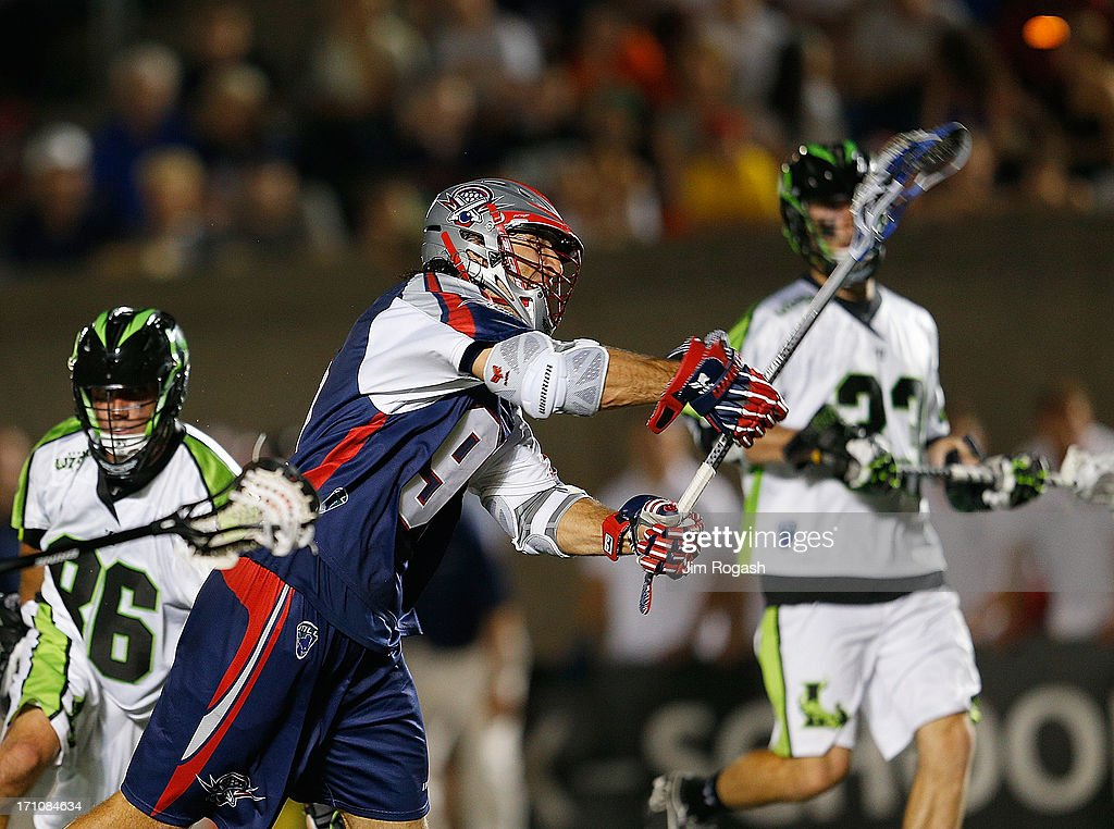 Paul Rabil #99 of the Boston Cannons shoots on net against the defense of Kevin Unterstein #86 and Mike Ward #23 of the New York Lizards in the second half at Harvard Stadium on June 21, 2013 in Boston, Massachusetts.