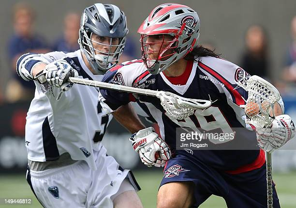 Paul Rabil of the Boston Cannons works his way around Matt Abbott of the Chesapeake Bayhawks in the second half at Harvard Stadium July 28 2012 in...