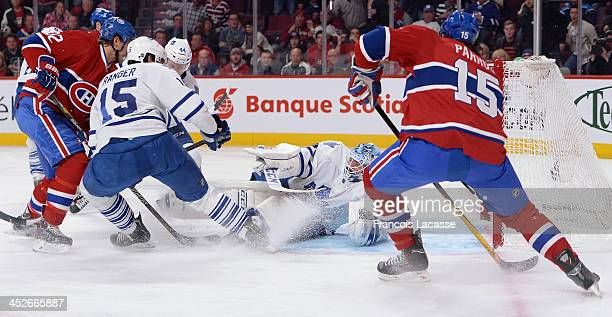 Paul Ranger and Jonathan Bernier of the Toronto Maple Leafs defend the net against George Parros and Travis Moen of the Montreal Canadiens during the...