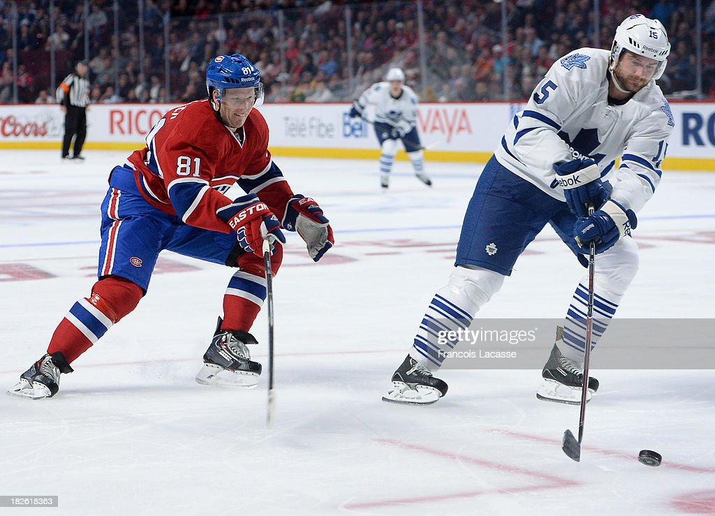 <a gi-track='captionPersonalityLinkClicked' href=/galleries/search?phrase=Paul+Ranger&family=editorial&specificpeople=544991 ng-click='$event.stopPropagation()'>Paul Ranger</a> #15 of the Toronto Maple Leafs controls the puck, followed by <a gi-track='captionPersonalityLinkClicked' href=/galleries/search?phrase=Lars+Eller&family=editorial&specificpeople=4324947 ng-click='$event.stopPropagation()'>Lars Eller</a> #81 of the Montreal Canadiens during the NHL game on October 1, 2013 at the Bell Centre in Montreal, Quebec, Canada.