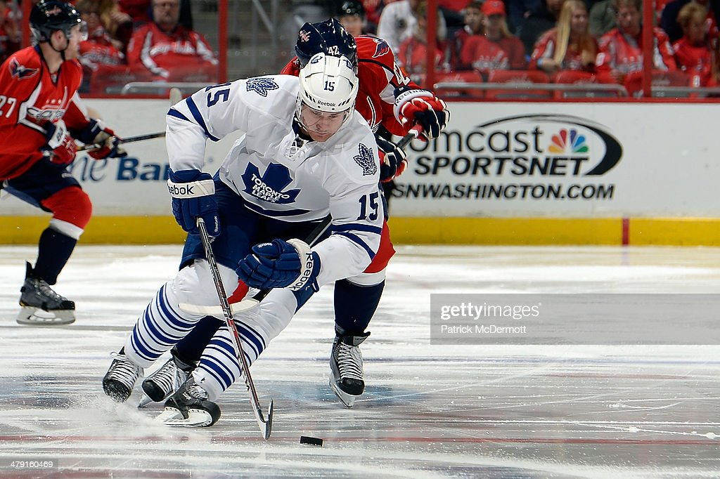 <a gi-track='captionPersonalityLinkClicked' href=/galleries/search?phrase=Paul+Ranger&family=editorial&specificpeople=544991 ng-click='$event.stopPropagation()'>Paul Ranger</a> #15 of the Toronto Maple Leafs moves the puck up ice against Joel Ward #42 of the Washington Capitals in the third period during an NHL game at Verizon Center on March 16, 2014 in Washington, DC.