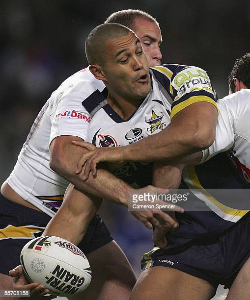 Paul Rauhihi of the Cowboys offloads the ball during the NRL Semi Final between the Melbourne Storm and the North Queensland Cowboys at Aussie...