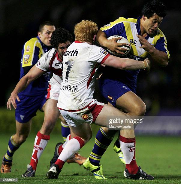 Paul Rauhihi of warrington is tackled by James Graham of StHelens during the engage Super League match between Warrington Wolves and StHelens at the...