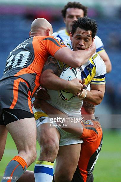 Paul Rauhihi of Warrington is tackled by Michael Vella of Hull KR during the Super League Magic Weekend match between Warrington Wolves and Hull KR...