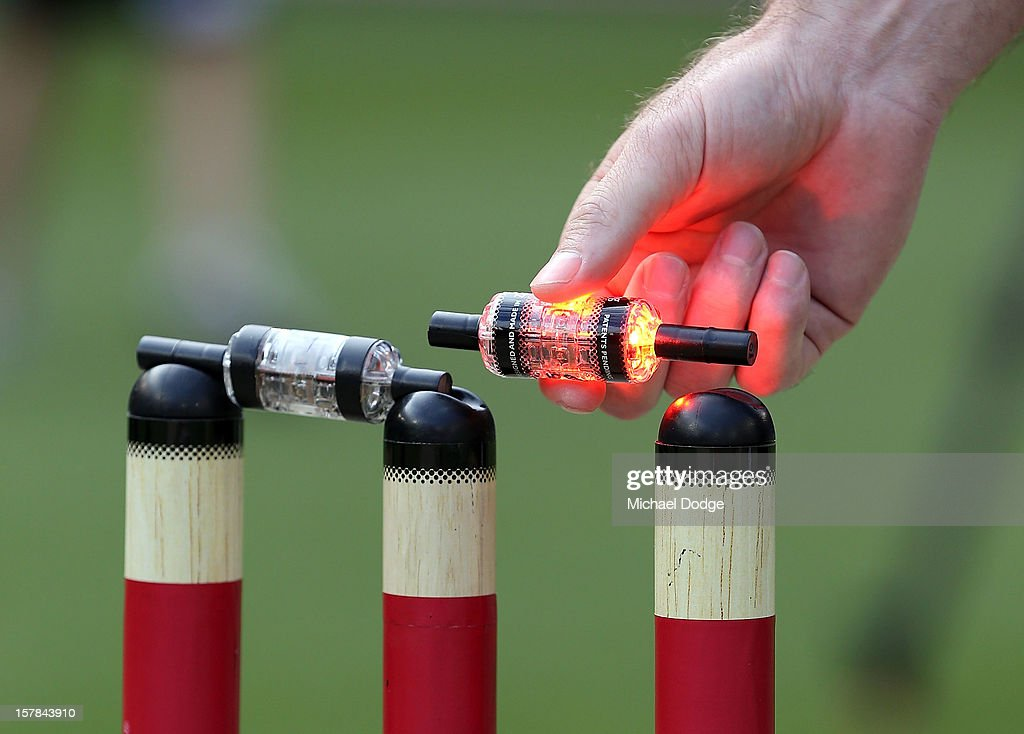 Paul Reiffel lifts up a bail which lights up before the Big Bash League match between the Melbourne Renegades and the Melbourne Stars at Etihad...