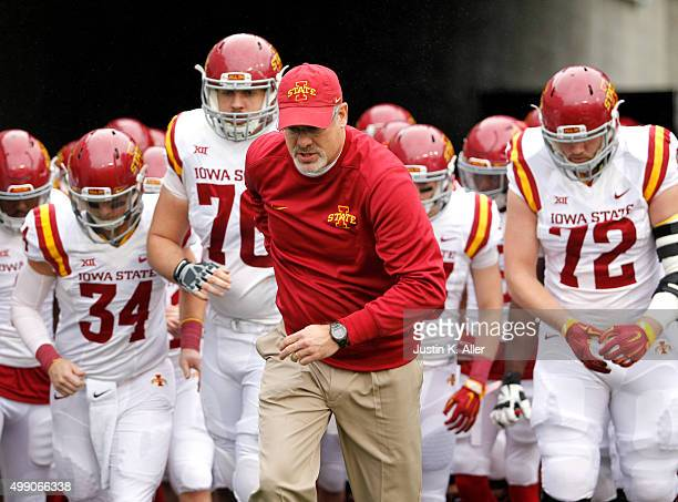 Paul Rhoads leads Iowa State onto the field during the game against the West Virginia Mountaineers on November 28 2015 at Mountaineer Field in...