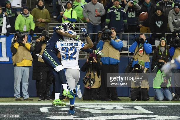Paul Richardson of the Seattle Seahawks makes a touchdown reception against Tavon Wilson of the Detroit Lions during the second quarter of the NFC...
