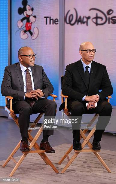 AMERICA Paul Richardson of The Walt Disney Company presents Dr Lomax President and CEO of UNCF with a donation on 'Good Morning America' 3/6/15...
