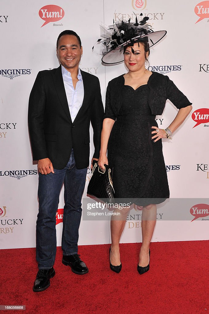 Paul Robinson and Jennifer Tilly attend the 139th Kentucky Derby at Churchill Downs on May 4, 2013 in Louisville, Kentucky.