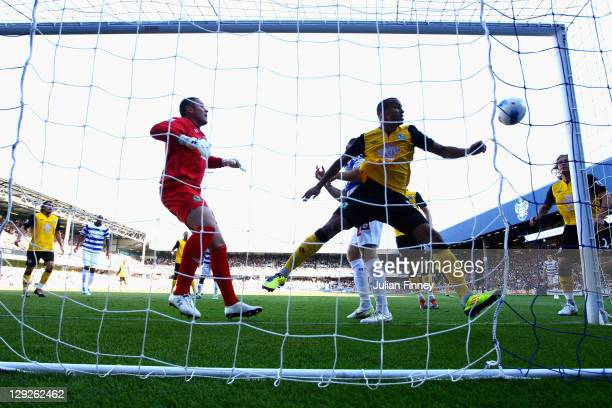 Paul Robinson and Martin Olsson of Blackburn Rovers watch the shot by Heidar Helguson of Queens Park Rangers loop over them and into the goal during...