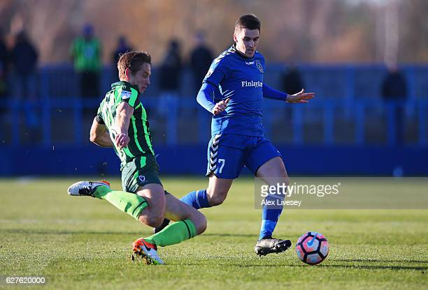Paul Robinson of AFC Wimbledon tackles Adam Morgan of Curzon Ashton during the Emirates FA Cup second round match between Curzon Ashton and AFC...