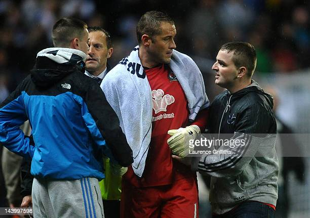 Paul Robinson of Blackburn Rovers is consoled by fans on the pitch at the end of the Barclays Premier League match between Blackburn Rovers and Wigan...