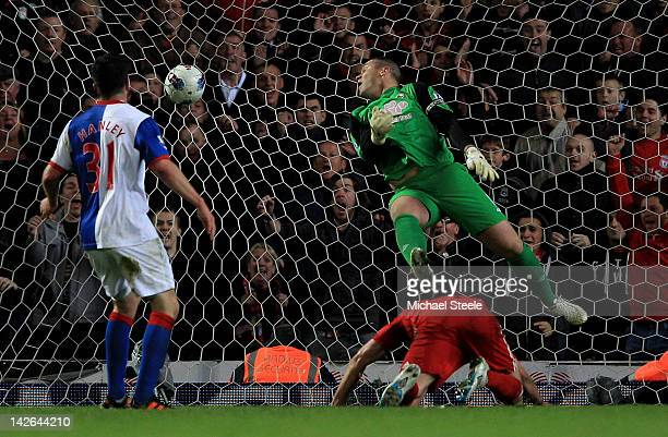 Paul Robinson of Blackburn Rovers is unable to stop Andy Carroll of Liverpool scoring the winning goal during the Barclays Premier League match...