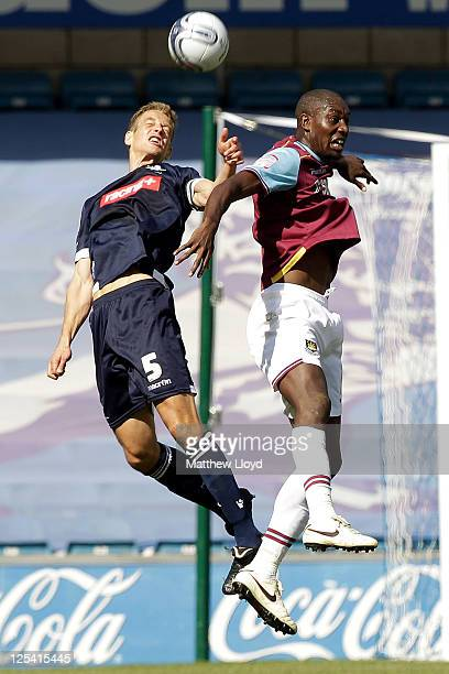 Paul Robinson of Millwall takes on Carlton Cole of West Ham United during the npower Championship match between Millwall and West Ham United at The...