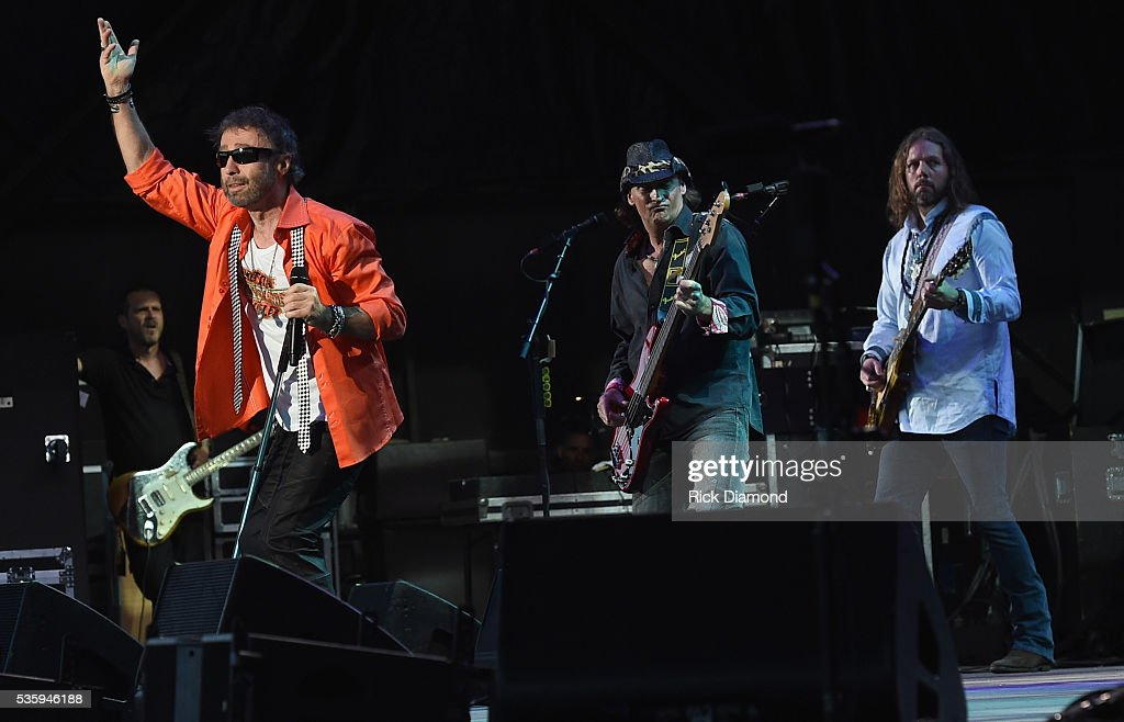Paul Rogers (orange shirt) and Rich Robinson (white shirt) of Bad Company perform during Joe Walsh & Bad Company One Hell Of A Night Tour - at Perfect Vodka Amphitheatre on May 29, 2016 in West Palm Beach, Florida.