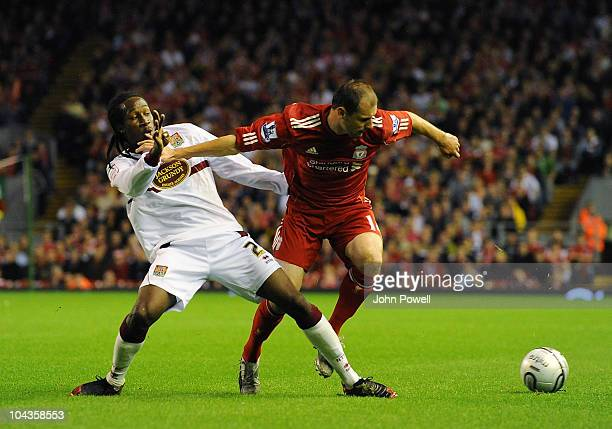 Paul rodgers of Northampton Town tussles with Milan Jovanovic of Liverpool during the Carling Cup 3rd round game between Liverpool and Northampton...