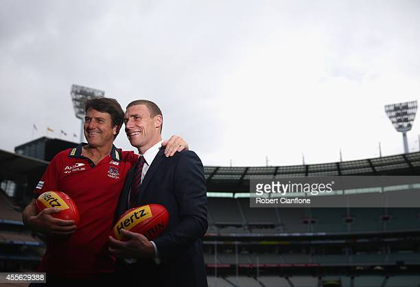 Paul Roos coach of the Demons poses with assistant coach Simon Goodwin after a Melbourne Demons AFL press conference at Melbourne Cricket Ground on...