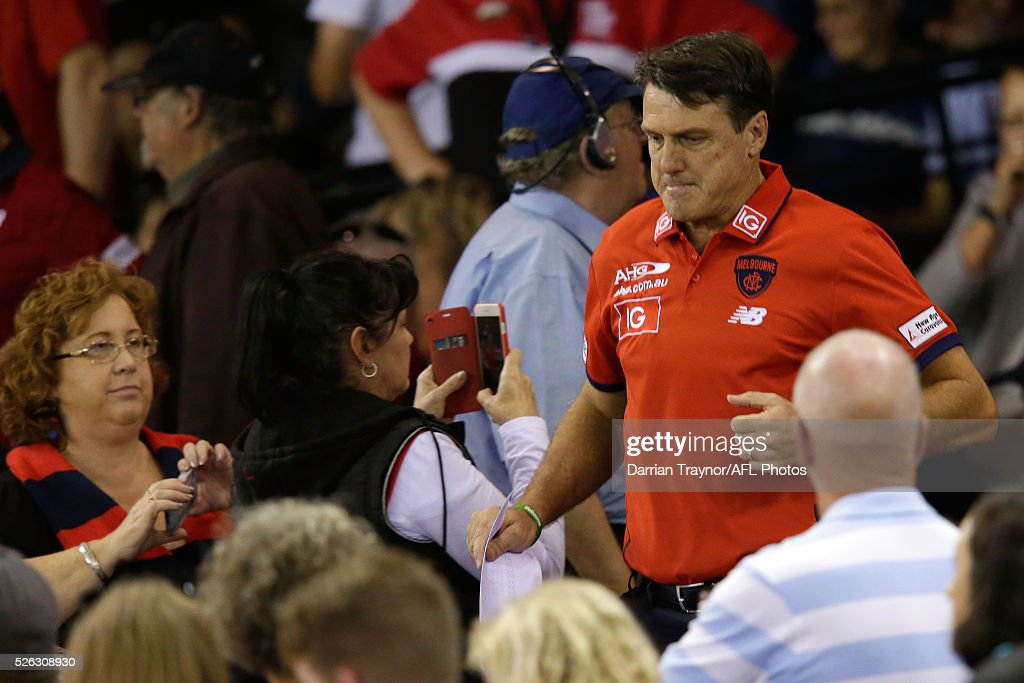 <a gi-track='captionPersonalityLinkClicked' href=/galleries/search?phrase=Paul+Roos&family=editorial&specificpeople=193840 ng-click='$event.stopPropagation()'>Paul Roos</a>, Senior Coach of the Demons heads down to the 3/4 time huddle during the 2016 AFL Round 06 match between the during the round six AFL match between the Melbourne Demons and the St Kilda Saints at Etihad Stadium on April 30, 2016 in Melbourne, Australia.