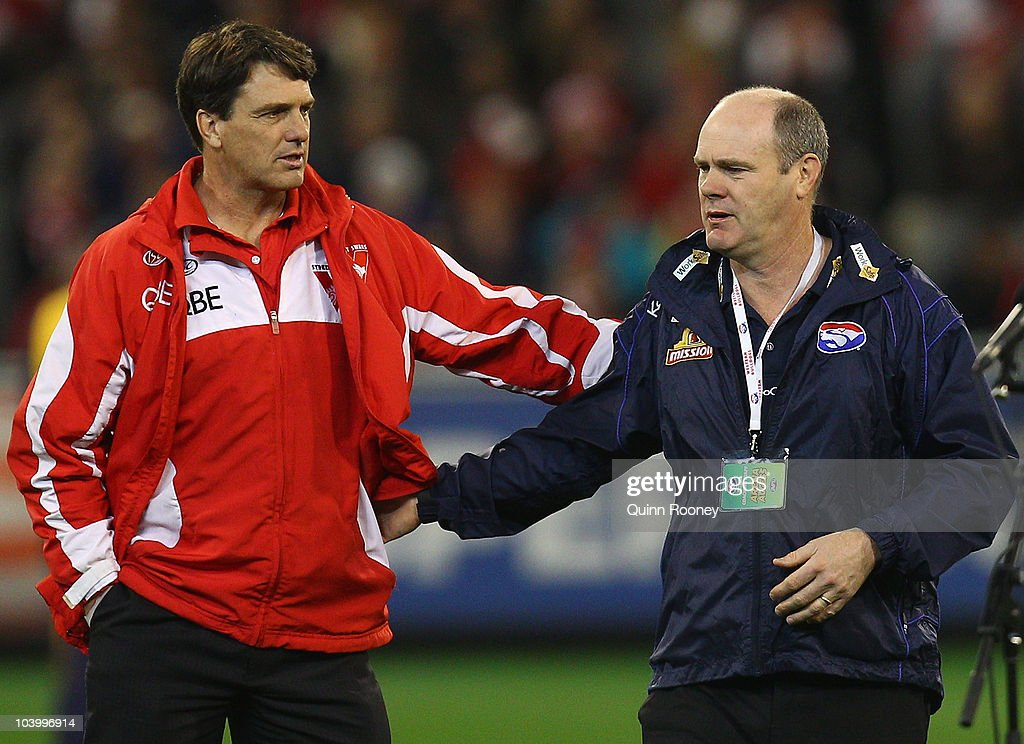 Paul Roos the coach of the Swans and Rodney Eade the coach of the Bulldogs speak before the start of the AFL First Semi Final match between the Western Bulldogs and the Sydney Swans at Melbourne Cricket Ground on September 11, 2010 in Melbourne, Australia.