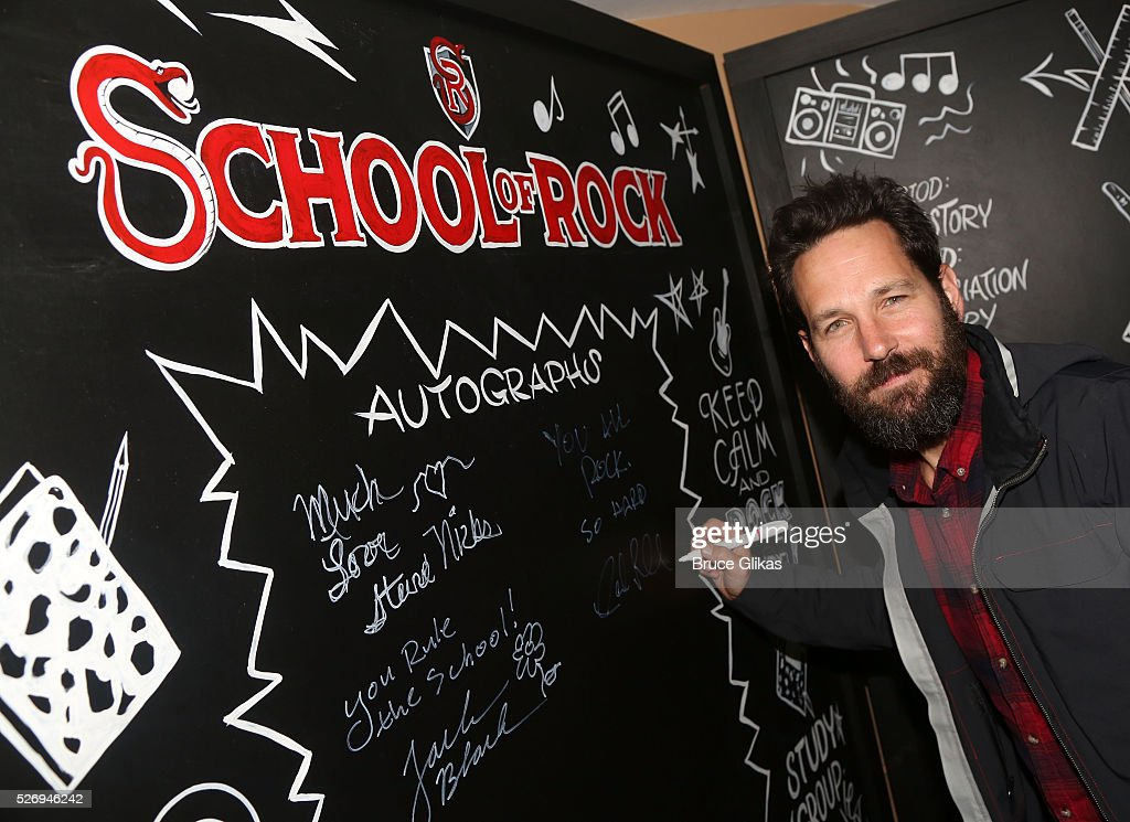 Paul Rudd signs the VIP room wall backstage at the hit musical based on the film starring Jack Black 'School of Rock' on Broadway at The Winter Garden Theatre on May 1, 2016 in New York City.