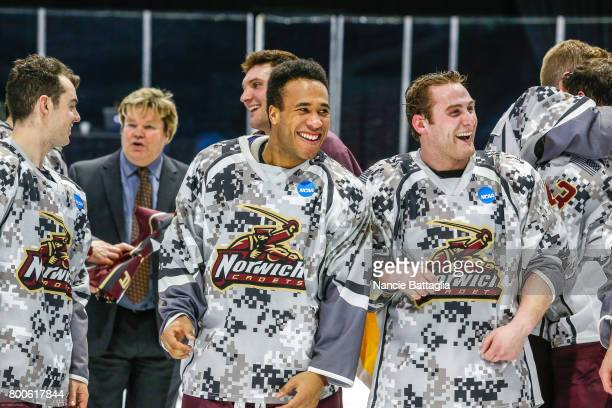 Paul Russell and Connor Evangelista of Norwich University fist bump in celebration of their 41 win over Trinity College in the Division lll Men's Ice...