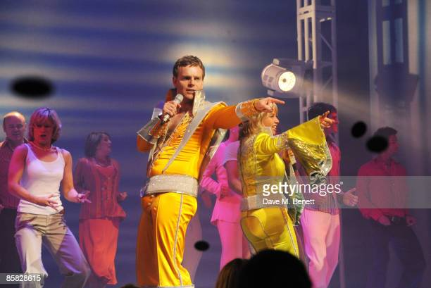 Paul RyanLinzi Hateley perform on stage during the Mamma Mia Gala Celebration Evening to celebrate their 10th birthday at the Prince of Wales Theatre...