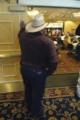 Paul Sanchez of Rio Arriba listens to a candidate's speech at the state republican convention at the Marriott hotel in Albuquerque NM