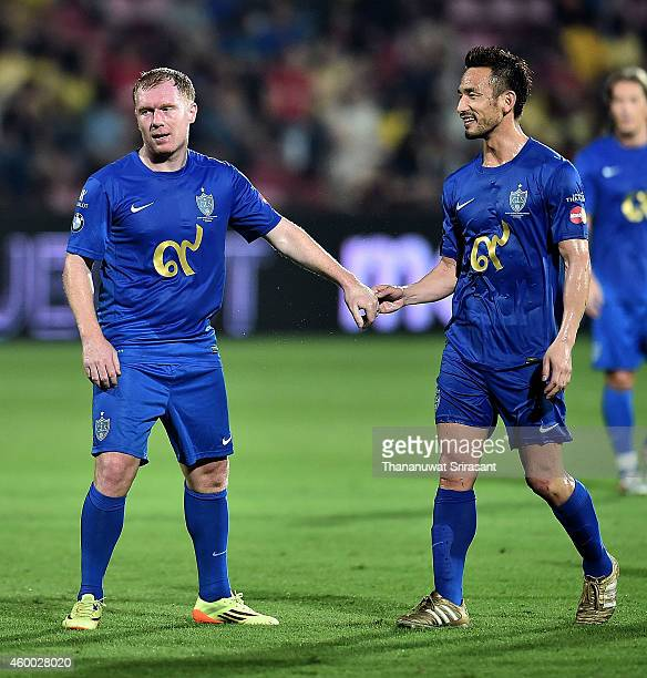 Paul Scholes and Hidetoshi Nakata of Team Cannavaro celebeates during the Global Legends Series match at the SCG Stadium on December 5 2014 in...