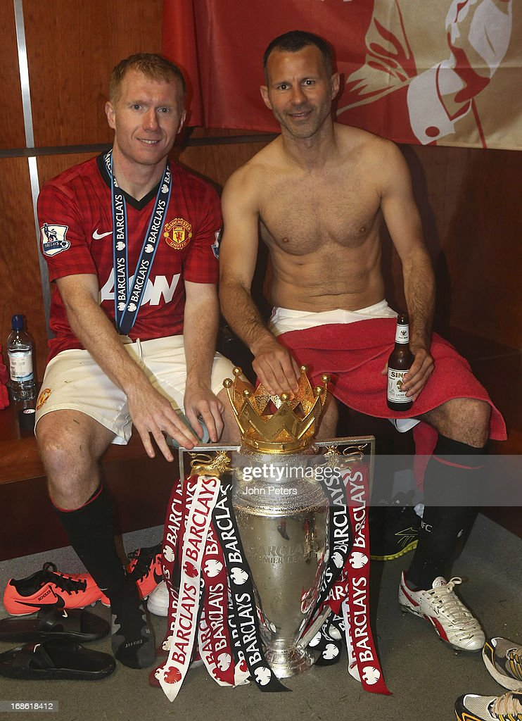 <a gi-track='captionPersonalityLinkClicked' href=/galleries/search?phrase=Paul+Scholes&family=editorial&specificpeople=171770 ng-click='$event.stopPropagation()'>Paul Scholes</a> and <a gi-track='captionPersonalityLinkClicked' href=/galleries/search?phrase=Ryan+Giggs&family=editorial&specificpeople=201666 ng-click='$event.stopPropagation()'>Ryan Giggs</a> of Manchester United celebrates with the Barclays Premier League trophy in the dressing room after the Barclays Premier League match between Manchester United and Swansea at Old Trafford on May 12, 2013 in Manchester, England.