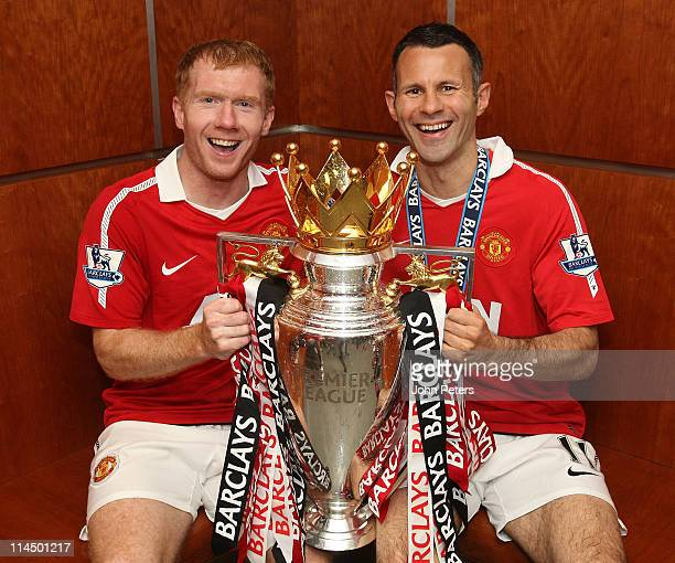 Paul Scholes and Ryan Giggs of Manchester United pose in the dressing room with the Barclays Premier League trophy after the Barclays Premier League...