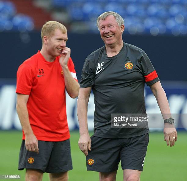 Paul Scholes and Sir Alex Ferguson of Manchester United in action during a first team training session ahead of their UEFA Champions League semifinal...