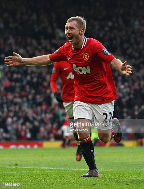 Paul Scholes of Manchester United celebrates after scoring the opening goal during the Barclays Premier League match between Manchester United and...