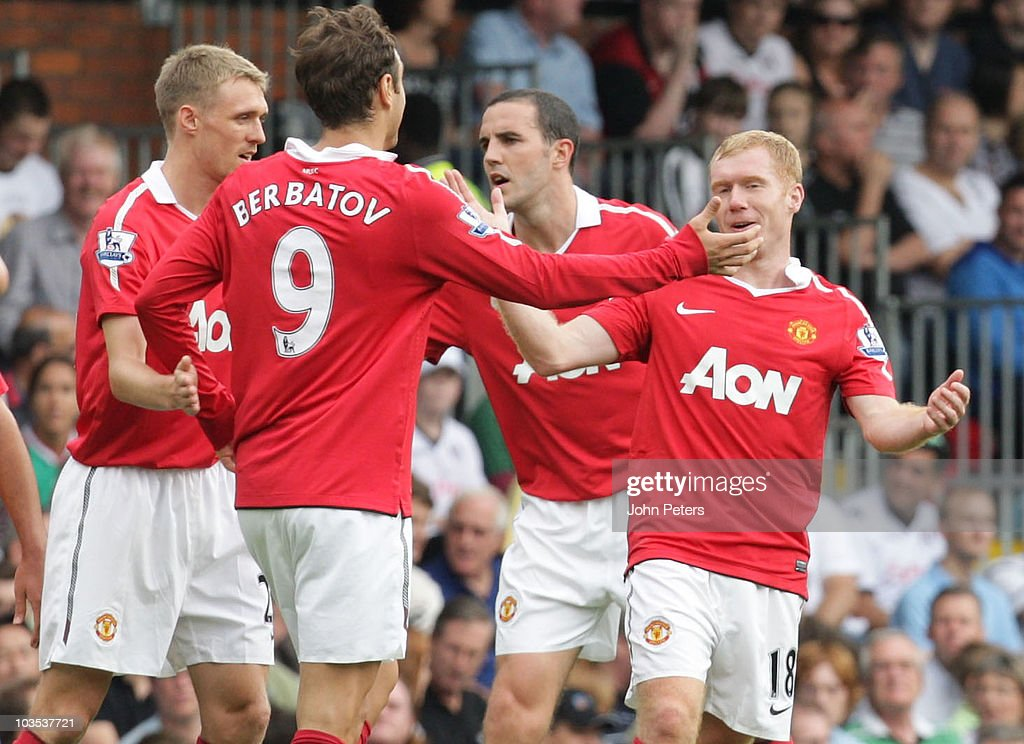 <a gi-track='captionPersonalityLinkClicked' href=/galleries/search?phrase=Paul+Scholes&family=editorial&specificpeople=171770 ng-click='$event.stopPropagation()'>Paul Scholes</a> of Manchester United (R) celebrates scoring their first goal during the Barclays Premier League match between Fulham and Manchester United at Craven Cottage on August 22, 2010 in London, England.
