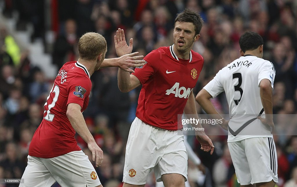 Paul Scholes (L) of Manchester United celebrates scoring their first goal with Michael Carrick during the Barclays Premier League match between Manchester United and Swansea City at Old Trafford on May 6, 2012 in Manchester, England.