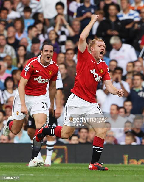 Paul Scholes of Manchester United celebrates with John O'Shea as he scores their first goal during the Barclays Premier League match between Fulham...