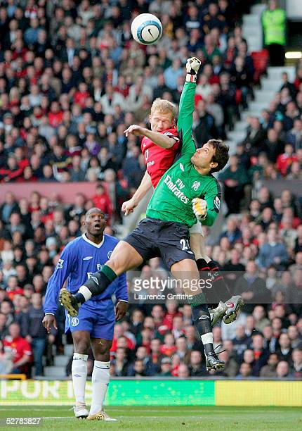 Paul Scholes of Manchester United challenges goalkeeper Carlo Cudicini of Chelsea for the ball during the FA Barclays Premiership match between...