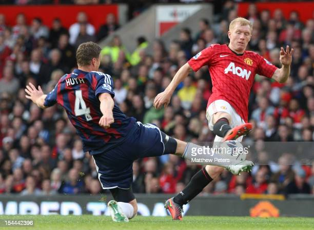 Paul Scholes of Manchester United clashes with Robert Huth of Stoke City during the Barclays Premier League match between Manchester United and Stoke...