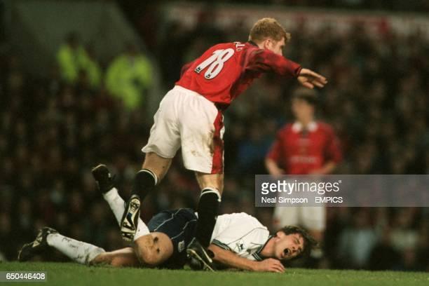 Paul Scholes of Manchester United fouls Nicola Berti of Tottenham Hotspur