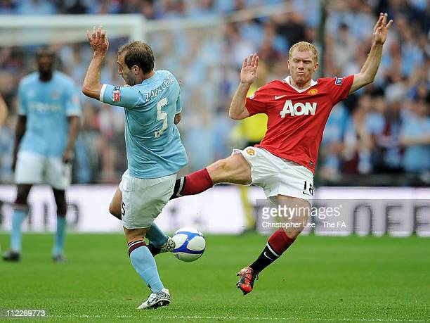 Paul Scholes of Manchester United fouls Pablo Zabaleta of Manchester City leading to his red card during the FA Cup sponsored by EON semi final match...